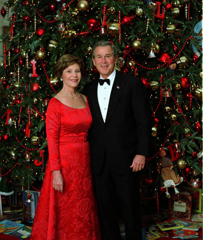Arnold Scaasi designed red dress worn by Laura Bush for a Dec. 7, 2003 portrait with President George W. Bush in front of the White House Christmas Tree. Courtesy of the George W. Bush Presidential Library and Museum. White House photo by Eric Draper.