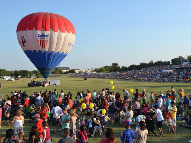 Crowds gather at the Plano Hot Air Balloon Festival