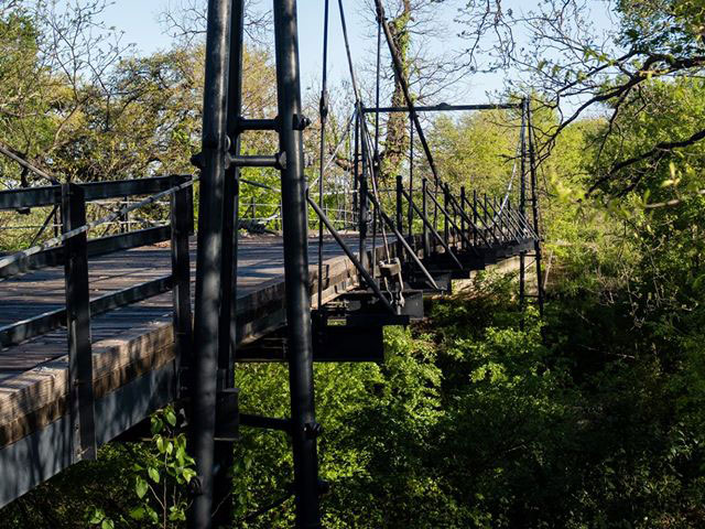 lovely san saba #5: Step on to the Beveridge Bridge, one of the last remaining suspension  bridges in the Lone Star State. Spanning the San Saba River just outside of  town, ...