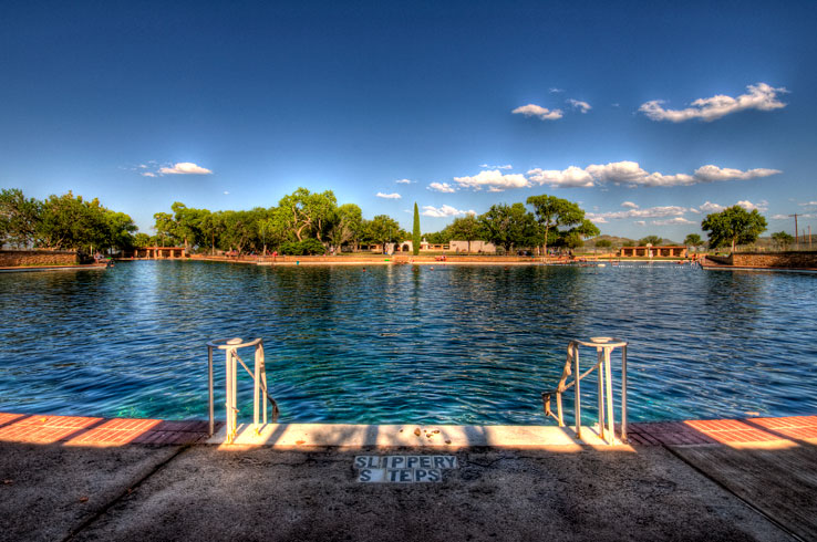 Dive into the crystal clear waters of Balmorhea State Park's swimming pool, the largest spring-fed pool in the world.
