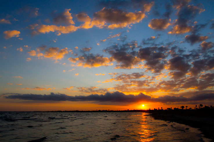 A stunning sunset at Rockport Beach, one of the top beaches on the Texas Gulf Coast.