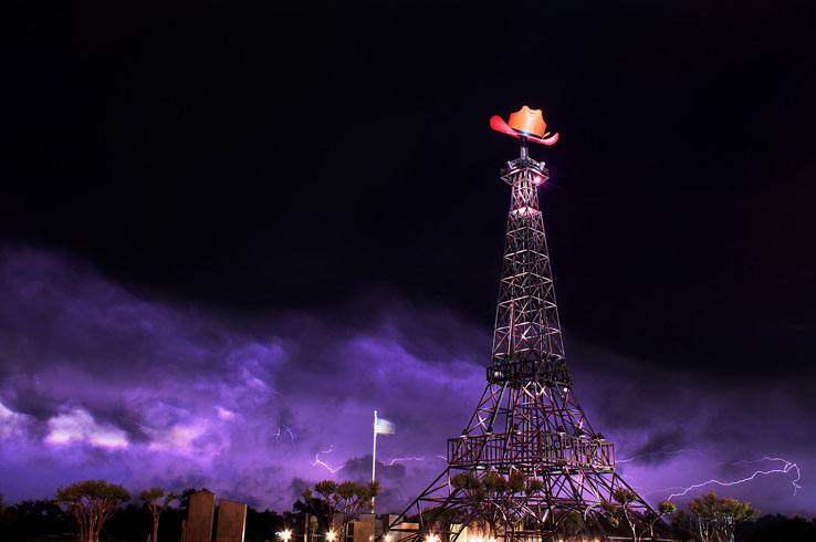 The Eiffel Tower in Paris, Texas, is a small-scale replica of the original adorned with a cowboy hat.