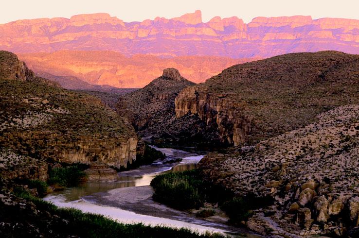 A beautiful Big Bend sunset illuminates the Rio Grande River.